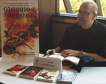 C. Dean Andersson signs books at FenCon in Dallas, Texas, September 2012 (photographed by Christopher Fulbright)