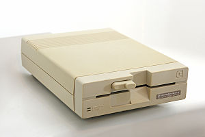 "Commodore 1541 - Commodore 1541-II, the second of two upgraded versions of the CBM 1541. The 1541-II has the more modern ""radial handle"" locking mechanism."