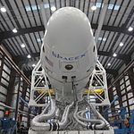 COTS-1 Spacecraft and Rocket in the Hangar.jpg
