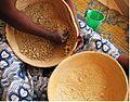 Calabash bowls - 3 hand processing millet flour forming pellets.jpg