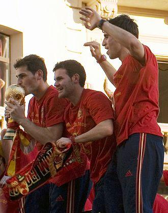 Javi Martínez - Martínez (furthest right) with Iker Casillas and Juan Mata after winning the 2010 World Cup