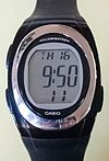 Digital LCD wristwatch Casio type F-E10 with electroluminescent backlighting.