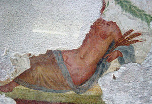 Mola salsa - Fragmentary Roman wall painting depicting the goddess Ceres holding stalks of wheat