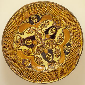 Slipware - Charger with Charles II in the Boscobel Oak, English, c. 1685. Such large plates, for display rather than use, take slip-trailing to an extreme, building up lattices of thick trails of slip.