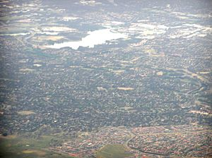 Charnwood, Australian Capital Territory - Charnwood is the treed area behind the bare Dunlop in this aerial picture looking to the southeast over Belconnen