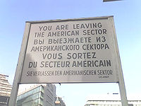 The sign at Checkpoint Charlie indicating the ...