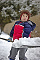 Child using a snow shovel to remove snow 02.jpg