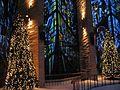 Christmas trees behind altar.JPG