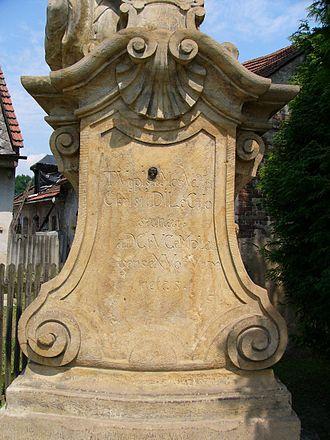 Chronogram - Chronogram at cross in Uničov (Czech Republic).  TVrpIs aMor VeXat  ChrIstI DILeCtIo  sanat  aD CrVCeM pLan-  gens eXVo tVrpe  nefas 1775