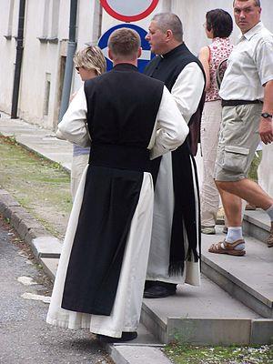 Scapular - 21st-century Cistercian monks in their habit (with hoodless black monastic scapular)