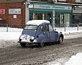 Citroën 2CV in snow at Tilehurst, Berkshire, England.jpg