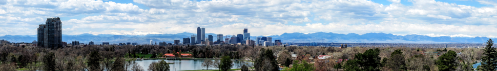 Panorama of Denver in early May, as seen from the Denver Museum of Nature and Science. Snow-capped Mount Evans can be seen to the left beyond the city skyline.