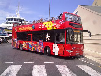 Gozo - City Sightseeing Gozo Hop-On Hop-Off open top bus FPY 004 at Mġarr.
