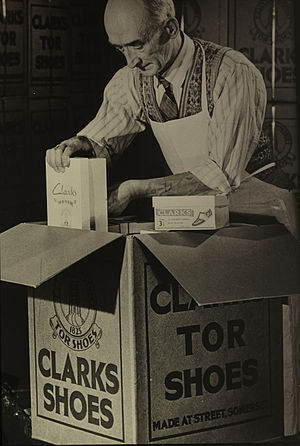C. & J. Clark - An employee carefully packing some of the premium Clarks Tor products
