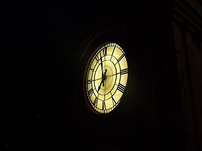 Clock tower clock in night, veegaland amusement park, Cochin, Kerala, India