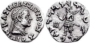 "Nicias (Indo-Greek king) - Coin of king Nicias (c. 90–85 BCE) Obv: Bust of Nicias with Greek legend BASILEOS SOTEROS NIKIOU ""Of Saviour King Nicias"". Rev: King in armour, holding a palm of victory in his left hand, and making a gesture of benediction with his right hand, similar to the Buddhist vitarka mudra. Kharoshti legend MAHARAJA TRATARASA NIKIASA ""Saviour King Nicias""."