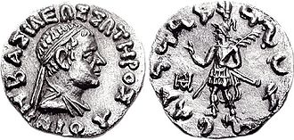 "Nicias (Indo-Greek king) - Coin of king Nicias (c. 90–85 BCE) Obv: Bust of Nicias with Greek legend ΒΑΣΙΛΕΩΣ ΣΩΤΗΡΟΣ ΝΙΚΙΟΥ ""Of Saviour King Nicias"". Rev: King in armour, holding a palm of victory in his left hand, and making a gesture of benediction with his right hand, similar to the Buddhist vitarka mudra. Kharoshti legend MAHARAJA TRATARASA NIKIASA ""Saviour King Nicias""."