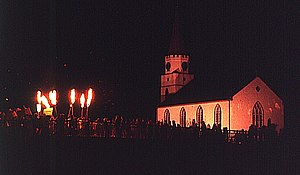 Comrie - Hogmanay flambeaux fire festival with the white church visible in background