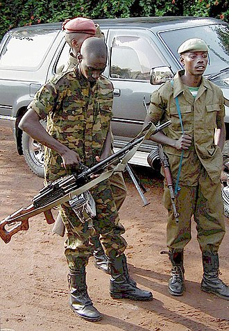Second Congo War - A Congolese soldier with a PK machine gun photographed near the Rwandan border in 2001