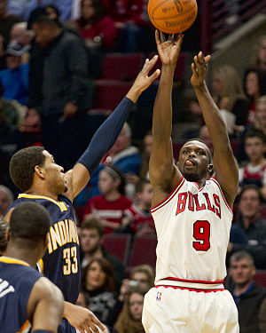 Luol Deng - Deng shooting a jump shot in a game with the Bulls