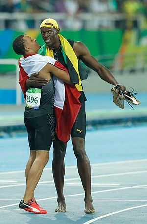 Andre De Grasse - De Grasse and Bolt after running the 100 m final at the 2016 Olympics.