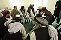 Defense.gov News Photo 101009-F-8920C-052 - U.S. Air Force 1st Lt. Rebecca Heyse the information operations officer for the Zabul Provincial Reconstruction Team listens as Afghan officials.jpg