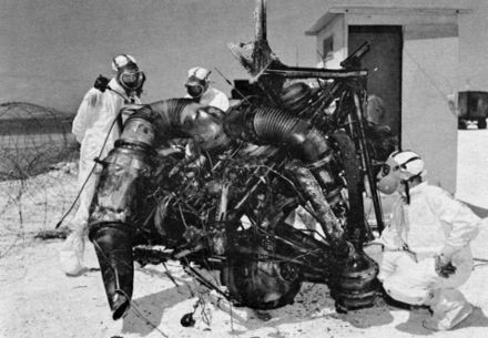 "Inspection of Thor rocket engine remains on Johnston Island after failure of ""Bluegill Prime"" nuclear test attempt, July 1962 Dominic Bluegill Prime radiation cleanup.jpg"