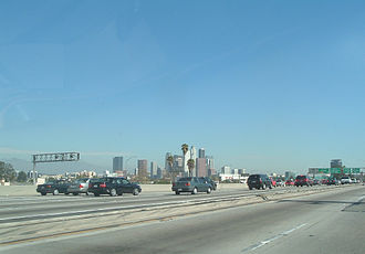 Interstate 10 in California - Downtown Los Angeles skyline as seen from the freeway. A slight (smaller than usual rush hour) traffic jam is ahead.