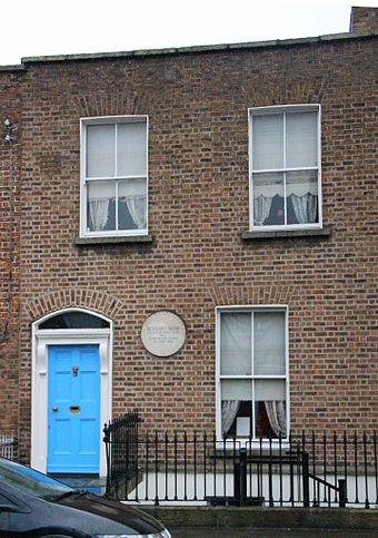 "Shaw's birthplace (2012 photograph). The plaque reads ""Bernard Shaw, author of many plays, was born in this house, 26 July 1856"". Dublin Portobello 33 Synge Street George Bernard Shaw Birthplace 2.JPG"