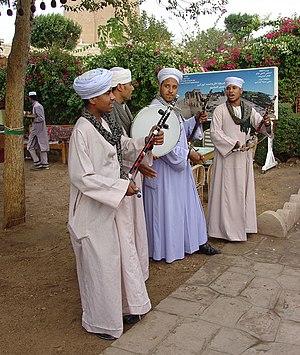 Egyptian musicians wearing gellabiyas (also sp...