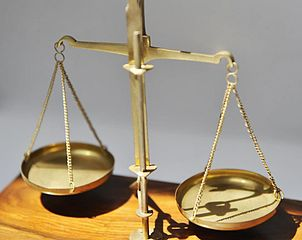 Two-pan scale, often used as a symbol of judgment or assessment
