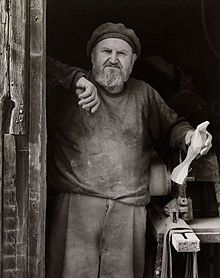 Photo of Emil Milan at his barn workshop c. 1980