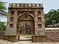 Entrance archway leading to enclosure near Jamali Kamali.jpg