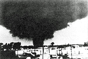 1953 Flint–Beecher tornado - An F4 tornado on June 8, 1953, near Erie, Michigan.  Photo courtesy of NOAA