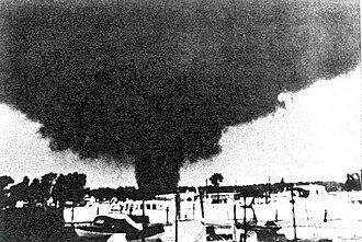 1953 Flint–Beecher tornado - An F4 tornado on June 8, 1953, near Erie, Michigan.  Photo courtesy of NOAA