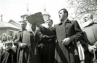 Old Believers - Lipovans (Russian Old Believers) during a ceremony in front of their church in the Romanian village of Slava Cercheză in 2004