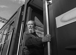 Solzhenitsyn boards a train in Vladivostok after returning to Russia from exile. Photo by Mikhail Evstafiev
