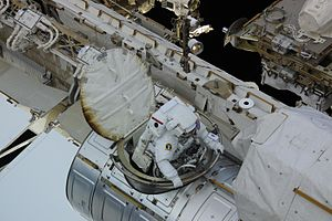 Expedition 24 - Wheelock egresses the Quest Airlock hatch on the ISS during the EVA 3 on 11 August 2010.