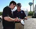 FEMA - 32262 - FEMA Community Relations worker meets with reporter.jpg
