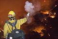 FEMA - 33376 - Northern California fire crew member shoots flare to set backburn.jpg