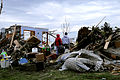 FEMA - 35461 - Residents stand in the debris of their hoome in Iowa.jpg