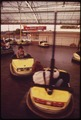 "FUN CITY, PART OF ""THE STRIP"" PLAYGROUND ARE, OFFERS A VARIETY OF AMUSEMENT RIDES. HERE, CUSTOMERS ENJOY THE BUMPER... - NARA - 551296.tif"