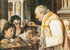 A priest sprinkles ashes on the heads of worhsippers.