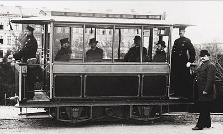Gross-Lichterfelde Tram in 1882. Early electric trams operated by the company lacked overhead wires, drawing current from the rails. First electric tram- Siemens 1881 in Lichterfelde.jpg