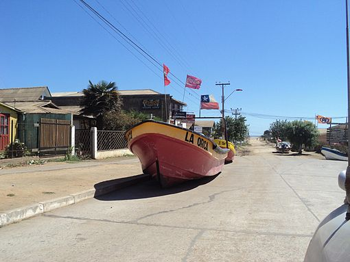 All of the fishing boats of Pichilemu were taken to higher ground after the tsunami warning issued on Friday morning. The boat pictured, La Orca, is in Agustín Ross Avenue. Image: Diego Grez.