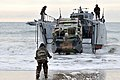 Flickr - Official U.S. Navy Imagery - French Marines approach the beach to deliver vehicles..jpg