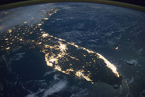 Conurbation - A satellite image of Florida showing South Florida (bottom right), which consists of hundreds of municipalities, as a continuous agglomeration of lights. Also, the Greater Orlando and Tampa areas encroach via the I-4 corridor.