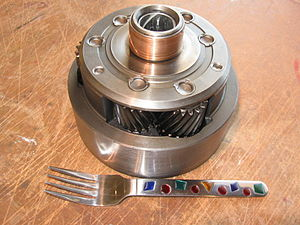 Cruise-O-Matic - Ravigneaux planet carrier from a Ford FMX, with a dinner fork to show scale