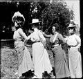 Four women posing in a line on shore of Lake Washington, 1900 (SEATTLE 4604).jpg