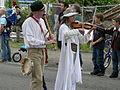 Fremont Solstice Parade 2007 flautist and fiddler.jpg